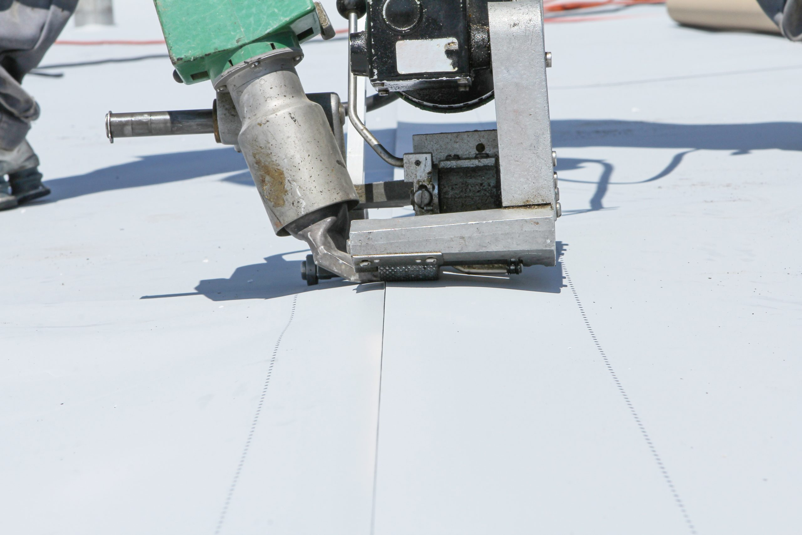 roofer joining white plastic sheets